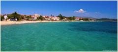 Песчаный пляж в Греции